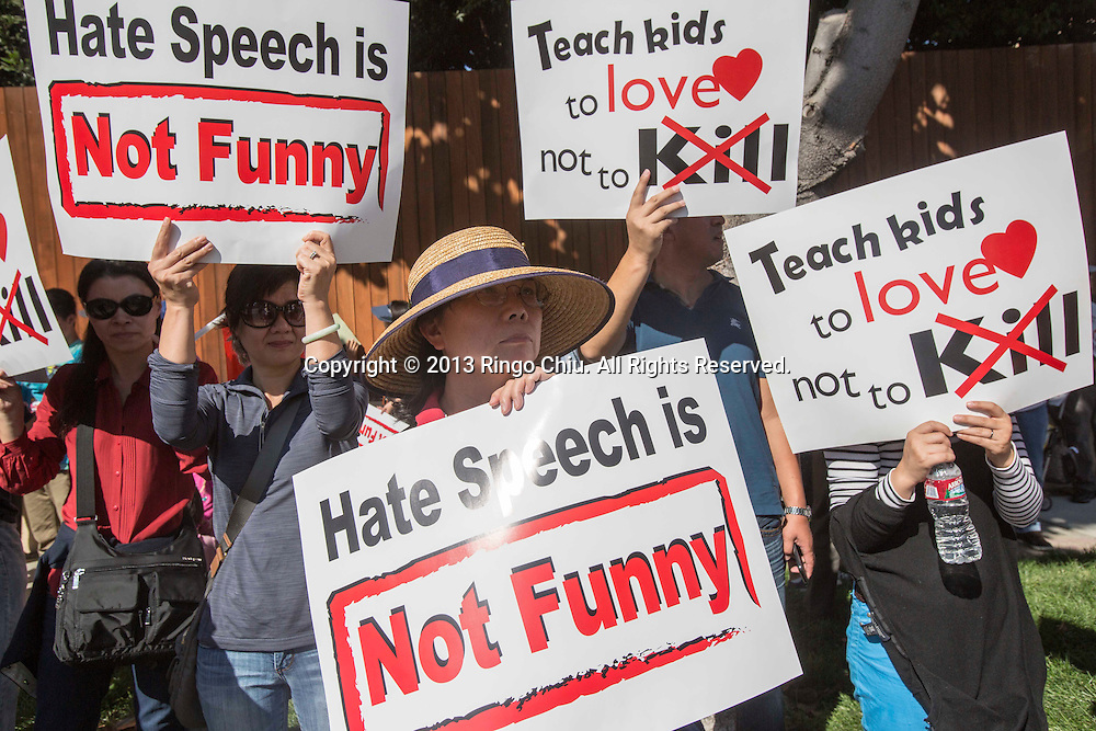 """Members from Chinese American organizations rally outside ABC headquarters on Saturday November 9, 2013 in Los Angeles, California, calling for the network to cancel comedian Jimmy Kimmel's late-night talk show in response to the """"kill everyone in China"""" skit. (Photo by Ringo Chiu/PHOTOFORMULA.com)"""