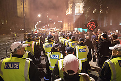 © Licensed to London News Pictures . 05/11/2016 . London , UK . Supporters of Anonymous marching in front of Parliament , many wearing Guy Fawkes masks , attend the Million Mask March bonfire night demonstration , at Trafalgar Square , in central London . Photo credit : Joel Goodman/LNP