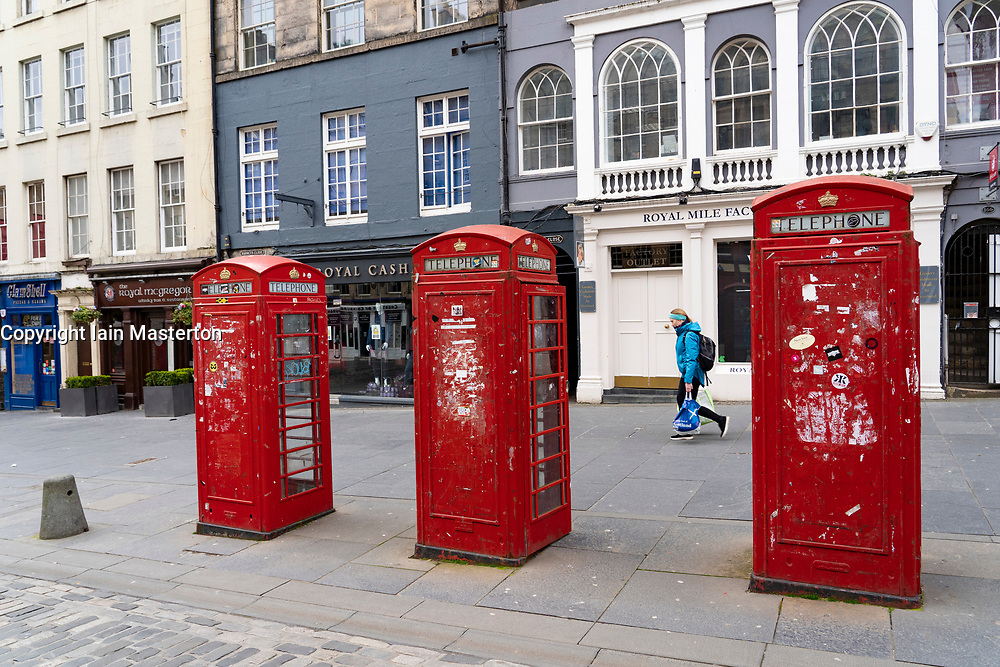 Edinburgh, Scotland, UK. 18 April 2020. Views of empty streets and members of the public outside on another Saturday during the coronavirus lockdown in Edinburgh. The Royal Mile is almost empty.  Iain Masterton/Alamy Live News