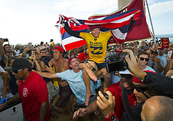 December 18, 2017 - Banzai Pipeline, HI, USA - BANZAI PIPELINE, HI - DECEMBER 18, 2017 - John John Florence of Hawaii is carried after winning the World Surf League World Title at the Billabong Pipe Masters. (Credit Image: © Erich Schlegel via ZUMA Wire)