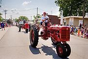 03 JULY 2021 - NORWALK, IOWA: Antique tractors participate in the 4th of July parade in Norwalk, Iowa. Last year's parade was cancelled because of the COVID-19 pandemic. Norwalk is an agricultural community south of Des Moines. In recent years, Norwalk has become a suburb of Des Moines.       PHOTO BY JACK KURTZ