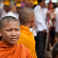 Young monk during the Bonn Kathen festival along a street leading to the Chong Khneas floating village.