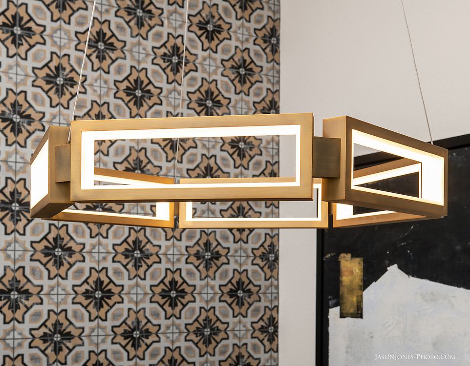 Mid Century Modern Inspired Chandelier in a contemporary multifamily residential setting.
