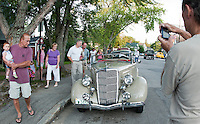 A 1935 Ford Roadster owned by Steve Gove of Laconia was being admired by spectators along Main Street in Meredith following the Cruise Night Parade Saturday evening.  (Karen Bobotas/for the Laconia Daily Sun)