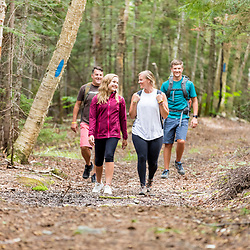 A family hikes on the Gardner Loop Trail, near Crater Pond in Aroostook County, Maine. Deboullie Public Reserve Land.