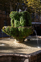 Fontaine des Neufs Canons – built in 1691 as the Fontaine Saint Lazare, this overgrown fountain renamed the 'Fountain of the Nine Canons' in 1761, served for a time as a source of water for religious communities in the area before being put to use as a watering trough for livestock especially sheep being herded from Arles to the Alps. It was ideal for this purpose because of its low height.  The fountain of 9 canons was built in 1651 by Laurent Vallon on the Cours Mirabeau and composed of two superimposed basins. It is registered as a historical monument since 1929