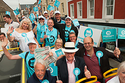 © Licensed to London News Pictures. 27/07/2019. Brecon, Powys, Wales, UK.Mark reckless MP (R) and Des Parkinson (2nd from right) set off on the Brexit Party bus with Brexit Party supporters in high spirits at the beginning of the day's campaigning. Des Parkinson, retired former Welsh police chief superintendent and Brexit Party candidate for the Brecon & Radnorshire constituency, continues his campaign in Mid Wales to win the seat in the forthcoming by-election on 1st August 2019.<br /> The by-election has been recalled because the incumbent Tory MP Chris Davies has been booted from the seat after a recall petition was passed when more than 10,000 voters backed the move. <br /> The Brexit Party was founded by former UKIP economics spokeswoman, Catherine Blaiklock in January 2019, and is led by Nigel Farage. The Brexit party has 29 Members of the European Parliament (MEPs) and four Welsh Assembly Members. The party's first major electoral success was winning the 2019 European Parliament election in the United Kingdom after four months in existence. Photo credit: Graham M. Lawrence/LNP