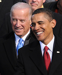 """File photo dated January 20, 2009 of President Barack Obama and Vice President Joe Biden share a laugh during prior to take the Oath of Office from Supreme Court Chief Justice John Roberts to become the 44th U.S. President and the first African-American elected, during the Inauguration ceremonies on Capitol Hill in Washington, D.C., USA. Former President Barack Obama endorsed Joe Biden, his two-term vice president, on Tuesday morning in the race for the White House. """"Choosing Joe to be my vice president was one of the best decisions I ever made, and he became a close friend. And I believe Joe has all the qualities we need in a president right now,"""" Obama said in a video posted to Twitter. Photo by Douliery/Hann/ABACAPRESS.COM"""