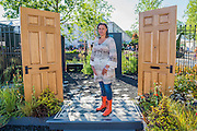 The Modern Slavery Garden with Designer Juliet Sargeant. The doors are to indicate that in the modern world slavery still goes on behind closed doors and the numbers represent different statistics.