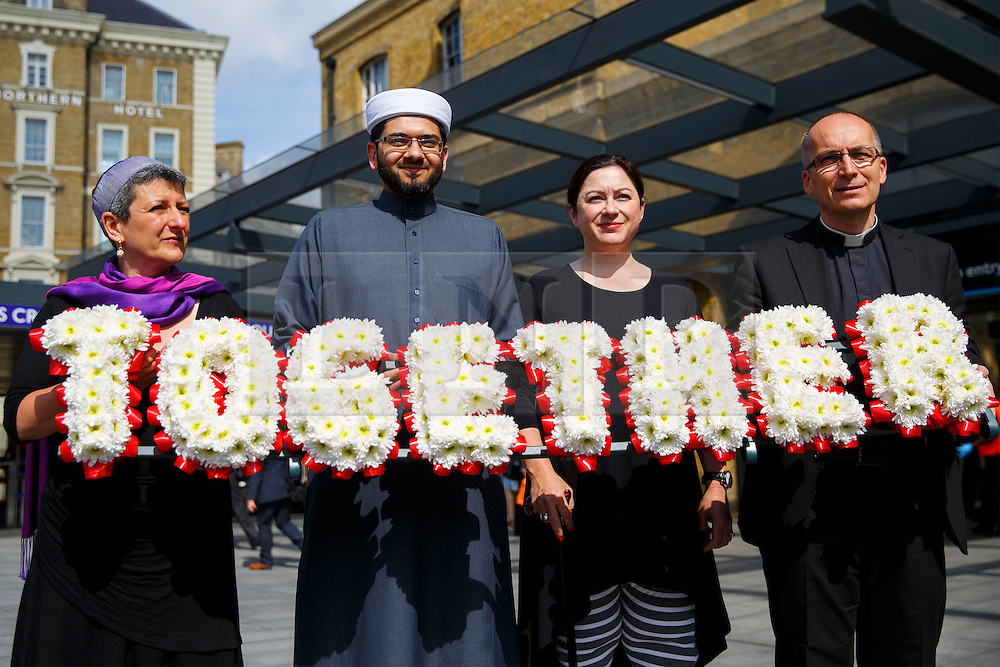 © Licensed to London News Pictures. 06/07/2015. London, UK. 7/7 survivor Gill Hicks (3rd left) walk with faith leaders: Rabbi Laura Janner-Klausner, Imam Qari Asim and Revd Bertrand Olivier from King's Cross station to Tavistock Square in a quiet moment of solidarity and reflection to commemorate the 10th anniversary of 7/7 bombings by remembering those who lost their lives, as well as offering a message of peace and unity between people of different faiths and backgrounds. Photo credit: Tolga Akmen/LNP