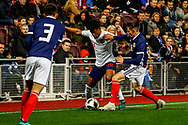 Reiss Nelson England U21s (Hoffenheim, loan from Arsenal) being gets along the touchline and around Michael Devlin  during the U21 UEFA EUROPEAN CHAMPIONSHIPS match Scotland vs England at Tynecastle Stadium, Edinburgh, Scotland, Tuesday 16 October 2018.