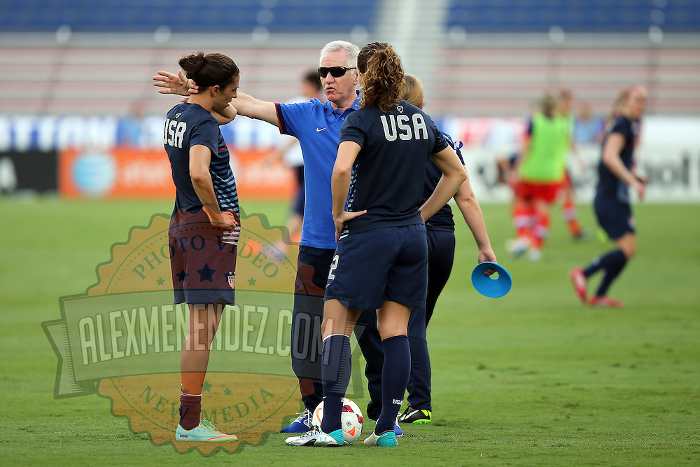 U. S. head coach Tom Sermanni speaks to his players prior to an international friendly soccer match between the United States Women's National soccer team and the Russia National soccer team at FAU Stadium on Saturday, February 8, in Boca Raton, Florida. The U.S. won the match by a score of 7-0. (AP Photo/Alex Menendez)