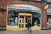 "Two people walk past a branch of fashion chain Joules on the second day of England's second coronavirus lockdown on 6 November 2020 in Windsor, United Kingdom. Only retailers selling ""essential"" goods and services are permitted to remain open to the public during the second lockdown but Joules has reported a 35% increase in online sales in 2020."