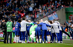 Chelsea team huddle together before the start of extra time during the Carabao Cup Final at Wembley Stadium, London.