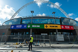 © Licensed to London News Pictures. 15/04/2021. LONDON, UK. A construction at work at the top of the Olympic Steps. Photocall at the soon to be completed Olympic Steps at Wembley Stadium.  The 48 Olympic Steps comprises 4 flights of 12 steps and will become the new gateway to the stadium for visitors and fans arriving from Olympic Way and is due to be completed in June 2021 in time for England group stage matches at Euro 2020.  Photo credit: Stephen Chung/LNP