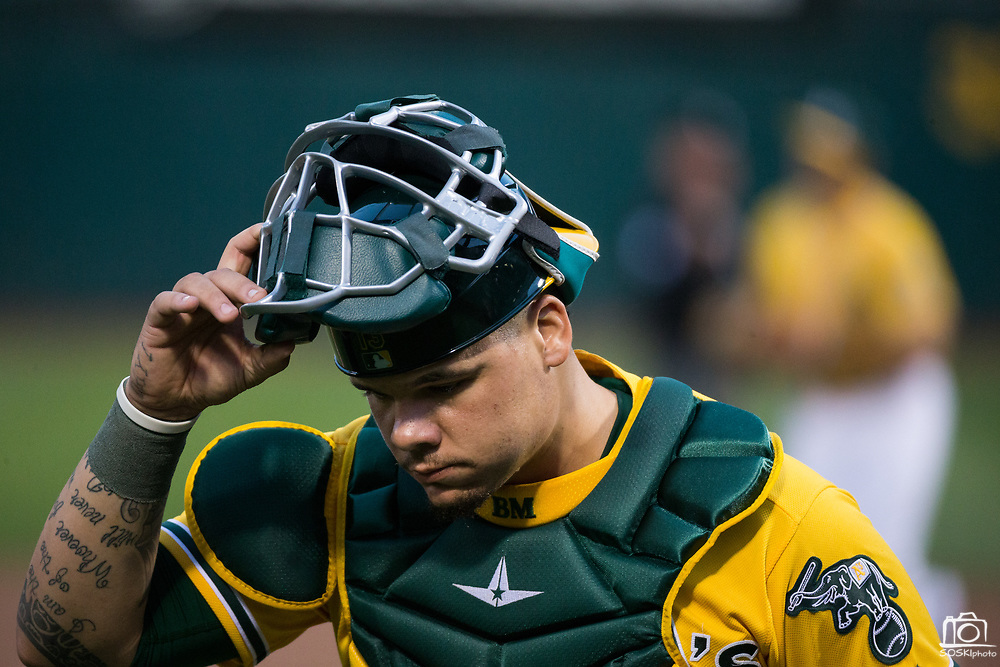 Oakland Athletics catcher Bruce Maxwell (13) walks off the field in between innings against the Los Angeles Angels at Oakland Coliseum in Oakland, California, on September 5, 2017. (Stan Olszewski/Special to S.F. Examiner)