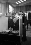 8/3/1965<br /> 3/8/1965<br /> 8 March 1965<br /> <br /> Éamon de Valera being shown the booths by An tath. Colman O huallachain O.F.M Director of AnTeanglann
