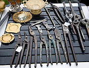 Old metal tools on display at a car boot sale, UK