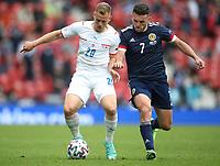 UEFA Euro 2020 Championship Group D match between Scotland v Czech Republic Hampden Park on June 14, 2021 in Glasgow, Scotland<br /> <br /> Matej Vydra on the ball with John McGinn closing in<br /> <br /> Credit: COLORSPORT/Ian MacNicol