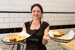 Vegan burgers are served up by Manager Arianna Bonesso at at London's first totally vegan chippy in Hackney, North East London. Hackney, London, October 08 2018.