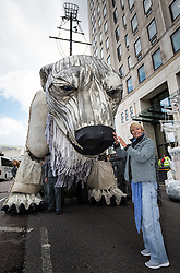 © Licensed to London News Pictures. 02/09/2015. London, UK. Actress Emma Thompson pictured outside the Shell Building on the Southbank today with 'Aurora', a large human operated Polar Bear built by Greenpeace activists who intend to picket outside the oil company's headquarters until they abandon plans to drill for oil in the Arctic. Photo credit : James Gourley/LNP