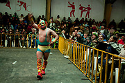 Male wrestler our of the ring singalling to the crowd. Lucha Libre wrestling origniated in Mexico, but is popular in other latin Amercian countries, including in La Paz / El Alto, Bolivia. Male and female fighters participate in the theatrical staged fights to an adoring crowd of locals and foreigners alike.