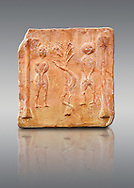 6th-7th Century Eastern Roman Byzantine  Christian Terracotta tiles depicting Adam & Eve with a serpent wrapped around a tree between them - Produced in Byzacena -  present day Tunisia. <br /> <br /> These early Christian terracotta tiles were mass produced thanks to moulds. Their quadrangular, square or rectangular shape as well as the standardised sizes in use in the different regions were determined by their architectonic function and were designed to facilitate their assembly according to various combinations to decorate large flat surfaces of walls or ceilings. <br /> <br /> Byzacena stood out for its use of biblical and hagiographic themes and a richer variety of animals, birds and roses. Some deer and lions were obviously inspired from Zeugitana prototypes attesting to the pre-existence of this province's production with respect to that of Byzacena. The rules governing this art are similar to those that applied to late Roman and Christian art with, in the case of Byzacena, an obvious popular connotation. Its distinguishing features are flatness, a predilection for symmetrical compositions, frontal and lateral representations, the absence of tridimensional attitudes and the naivety of some details (large eyes, pointed chins). Mass production enabled this type of decoration to be widely used at little cost and it played a role as ideograms and for teaching catechism through pictures. Painting, now often faded, enhanced motifs in relief or enriched them with additional details to break their repetitive monotony.<br /> <br /> The Bardo National Museum Tunis, Tunisia.   Against a grey background.