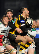 Wycombe, GREAT BRITAIN,  Wasps' Chris BISHAY, collects the high ball, Quins. Jim EVANS tackling, London Wasps vs Harlequins at Adam's Park Stadium, Bucks on Sun 04.01.2009. [Photo, Peter Spurrier/Intersport-images]