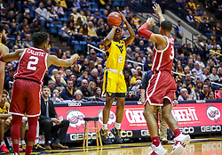 Feb 2, 2019; Morgantown, WV, USA; West Virginia Mountaineers guard Brandon Knapper (2) shoots a three pointer during the second half against the Oklahoma Sooners at WVU Coliseum. Mandatory Credit: Ben Queen-USA TODAY Sports