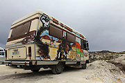 The most original caravans were waiting in the main road, 20 minute walk from the camp site.  European Rainbow Gathering of 2011 in Portugal