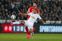 Wayne Routledge of Swansea City is challenged by Emre Can of Liverpool - Photo mandatory by-line: Rogan Thomson/JMP - 07966 386802 - 16/03/2015 - SPORT - FOOTBALL - Swansea, Wales — Liberty Stadium - Swansea City v Liverpool - Barclays Premier League.