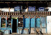 Shop fronts in Thimphu: Potala Restaurant and Bar, Cobbler and General Store. Thimpu, Druk Yul, Bhutan. 13 November 2007.