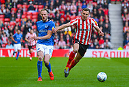 Matthew Clarke of Portsmouth (5) and Charlie Wyke of Sunderland (9) in action during the EFL Sky Bet League 1 first leg Play Off match between Sunderland and Portsmouth at the Stadium Of Light, Sunderland, England on 11 May 2019.