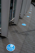 Social distance markers are on the ground at the entrance to the Roof Garden for when this popular rooftop viewpoint across the capital re-opens again when restrictions of the UK Coronavirus pandemic lockdown rules are realxed further. The number of deaths from Coronavirus in the last 24hrs has increased by 287 to 37,979 while the UK government lowered the national Covid-19 alert level from 4 to 3, meaning the virus is considered to be in general circulation .. with a gradual reduction in restrictions, on 19th June 2020, in the City of London, England.