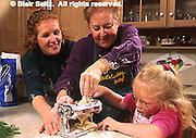 Mother, daughter and grandchild make noodles