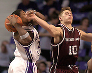 Kansas State's Cartier Martin (L) is fouled by Texas A&M's Chris Walker (R) going for a rebound, during K-State's 58-54 win over the Aggies at Bramlage Coliseum in Manhattan, Kansas, January 18, 2006.