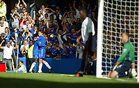 Photograph: Scott Heavey.<br />Chelsea v Tottenham Hotspur from Stamford Bridge. 13/09/2003.<br />Frank Lampard celebrates with Celestine Babayaro.