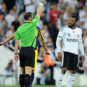 Referee's Tolga OZKALFA show the yellow card to Besiktas's Manuel FERNANDES (R) during their Turkish superleague soccer match Besiktas between MKE Ankaragucu at BJK Inonu Stadium in Istanbul Turkey on Monday, 19 September 2011. Photo by TURKPIX