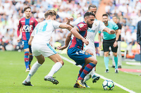 Real Madrid's Marcos Llorente and Lucas Vazquez and Levante's Ivan Lopez during La Liga match between Real Madrid and Levante UD at Santiago Bernabeu Stadium in Madrid, Spain September 09, 2017. (ALTERPHOTOS/Borja B.Hojas)