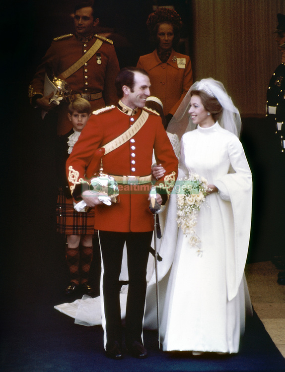 Princess Anne and Captain Mark Phillips leaving the west door of Westminster Abbey in London after their wedding ceremony.
