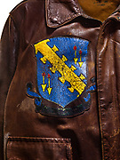 This type A-2 flight jacket belonged to Bruce Lowe, a navigator attached to the 568th squadron. The patch on the front, a panther riding on top of a bomb, was the 568th squadron patch. While the artwork on the right breast of the jacket was the insignia for his brother's B-26 squadron. Both Bruce and his twin brother wore this jacket on raids over Europe. Bruce completed 25 combat missions as a navigator with the 390th Bomb Group, before flying 10 missions with the 96th Bomb Group as the Pathfinder Lead Navigator.