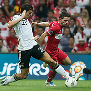Turkey's Gokhan GONUL (R) and Germany's Mario GOMEZ (L) during their UEFA EURO 2012 Qualifying round Group A matchday 19 soccer match Turkey betwen Germany at TT Arena in Istanbul October 7, 2011. Photo by TURKPIX