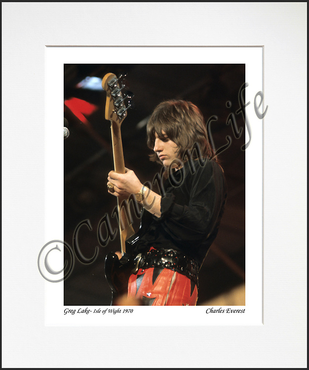 """Greg Lake - An affordable archival quality matted print ready for framing at home.<br />  Ideal as a gift or for collectors to cherish, printed on Fuji Crystal Archive photographic paper set in a neutral mat (all mounting materials are acid free conservation grade). <br />  The image (approx 6""""x8"""") sits within a titled border. The outer dimensions of the mat are approx 10""""x12""""."""