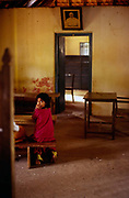 A child in a classroom at the school for Dalits (untouchables) that was built by Arundhati Roy's grandfather, Aymanam, Kerala, India.<br /> The God of Small Things (1997) is a politically charged novel by Indian author Arundhati Roy. It is a story about the childhood experiences of a pair of fraternal twins who become victims of circumstance. The book is a description of how the small things in life build up, translate into people's behavior and affect their lives. The book won the Booker Prize in 1997.