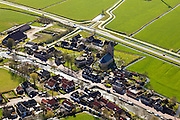 Nederland, Friesland, Gemeente Sudwest-Fryslan (Zuidwest-Friesland), 16-04-2012. het dorp Parrega aan de trekvaart naar Workum. De Sint-Johannes de Doperkerk (hervormde kerk) heeft een omgracht kerkhof..Village with church in Frisian country side..luchtfoto (toeslag), aerial photo (additional fee required);.copyright foto/photo Siebe Swart