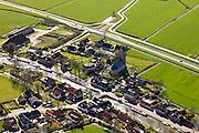 Nederland, Friesland, Gemeente Sudwest-Fryslan (Zuidwest-Friesland), 16-04-2012. het dorp Parrega aan de trekvaart naar Workum. De Sint-Johannes de Doperkerk (hervormde kerk) heeft een omgracht kerkhof..Village with church in Frisian country side..luchtfoto (toeslag), aerial photo (additional fee required);.copyright foto/photo Siebe Swart