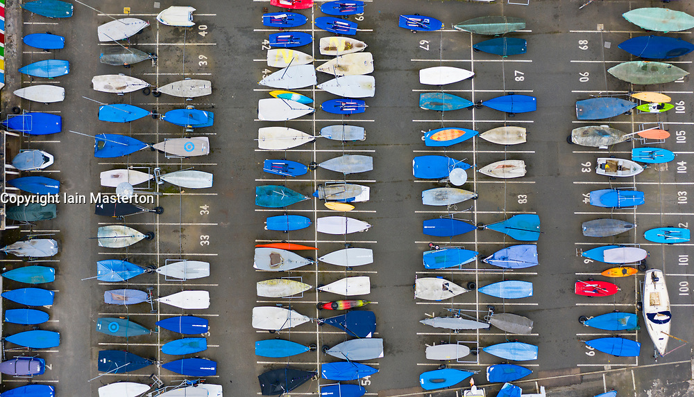North Berwick, Scotland, UK. 14 March 2021. Sailing boats stored in rows on dry land at North Berwick harbour in East Lothian.  The Covid-19 lockdown has led to much less participation watersports in the UK. Iain Masterton/Alamy Live News