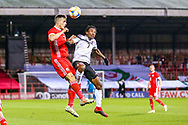 Wales midfielder Will Vaulks and Trinidad and Tobago midfielder Cordell Cato clash in the air during the Friendly European Championship warm up match between Wales and Trinidad and Tobago at the Racecourse Ground, Wrexham, United Kingdom on 20 March 2019.