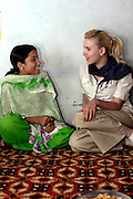 16 year old Raekha Chahan shares a joke with Scarlett. Raekha was beaten by her father, by joining change makers, an organisation for the empowerment of abused women, she has been able to take control of her life.