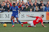AFC Wimbledon attacker Michael Folivi (41) dribbling past Charlton Athletic defender Patrick Bauer (5) during the EFL Sky Bet League 1 match between AFC Wimbledon and Charlton Athletic at the Cherry Red Records Stadium, Kingston, England on 23 February 2019.